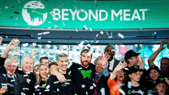 Beyond Meat CEO Ethan Brown  celebrates with guests after ringing the opening bell at Nasdaq in New York.
