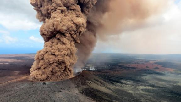 In this handout photo provided by the U.S. Geological Survey, a column of robust, reddish-brown ash plume occurred after a magnitude 6.9 South Flank following the eruption of Hawaii's Kilauea volcano on May 4, 2018 in the Leilani Estates subdivision near Pahoa, Hawaii. The governor of Hawaii has declared a local state of emergency near the Mount Kilauea volcano after it erupted following a 5.0-magnitude earthquake, forcing the evacuation of nearly 1,700 residents.