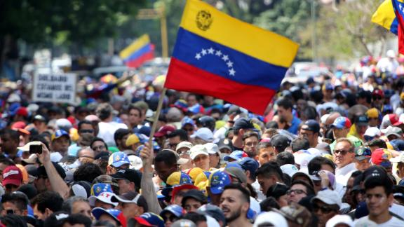 CARACAS, VENEZUELA - MAY 01: Supporters of Juan Guaido wave a flag of Venezuela during the May 1 demonstration at plaza Altamira on May 1, 2019 in Caracas, Venezuela. Yesterday, Venezuelan opposition leader Juan Guaidó, recognized by many members of the international community as the country