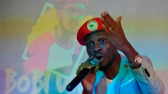 Ugandan pop star turned opposition MP Robert Kyagulanyi, popularly known by pop name Bobi Wine, listens to presentation at the PAWA 254  offices in October 12, 2018, Nairobi, where he met the youth and spoke on several issues affecting the youth in East Africa. (Photo by SIMON MAINA / AFP)        (Photo credit should read SIMON MAINA/AFP/Getty Images)
