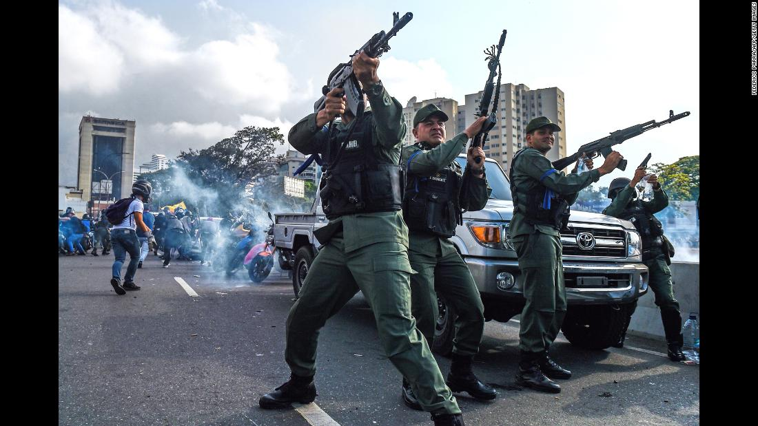 "Members of the Venezuelan military who support opposition leader Juan Guaido fire into the air to repel forces loyal to embattled President Nicolas Maduro on Tuesday, April 30. The Maduro forces were trying to disperse a demonstration near La Carlota, a military base in the capital of Caracas, after Guaido tried to spark an uprising. <a href=""http://www.cnn.com/2019/04/30/americas/gallery/venezuela-crisis/index.html"" target=""_blank"">In photos: Venezuela in crisis</a>"