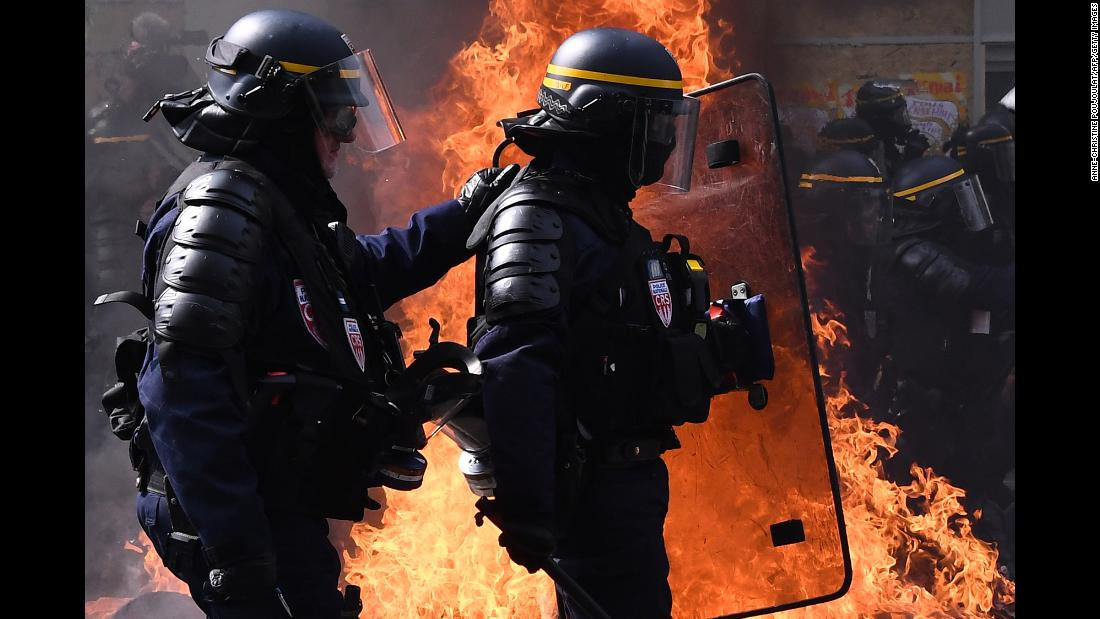 "Police walk past a burning barricade as they clash with protesters during a May Day demonstration in Paris on Wednesday, May 1. French authorities fired tear gas at crowds as <a href=""https://www.cnn.com/2019/05/01/europe/paris-may-day-protests-intl/index.html"" target=""_blank"">violent scuffles broke out</a> with protesters. <a href=""http://www.cnn.com/2019/05/01/world/gallery/may-day-2019/index.html"" target=""_blank"">In photos: May Day rallies around the world</a>"