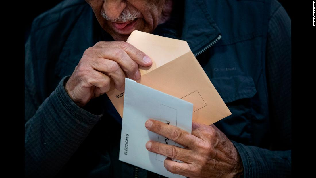 "A man in Pozuelo de Alarcon, Spain, prepares to cast his vote in the country's general election on Sunday, April 28. The center-left Socialist Workers' Party <a href=""https://www.cnn.com/2019/04/28/europe/spain-elections-early-intl/index.html"" target=""_blank"">won the election,</a> taking 123 out of the 350 seats in parliament."