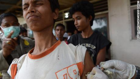 A Rohinyga boy from Myanmar reacts as he receives vaccinations against measles and tetanus from Indonesian health department personnel at the newly set up confinement area in Bayeun, Aceh province on May 22, 2015 after more than 400 Rohingya migrants from Myanmar and Bangladesh were rescued by Indonesian fishermen off the waters of the province on May 20. The widespread persecution of the impoverished community in Rakhine state is one of the primary causes for the current regional exodus, alongside growing numbers trying to escape poverty in neighbouring Bangladesh.  AFP PHOTO / ROMEO GACAD        (Photo credit should read ROMEO GACAD/AFP/Getty Images)