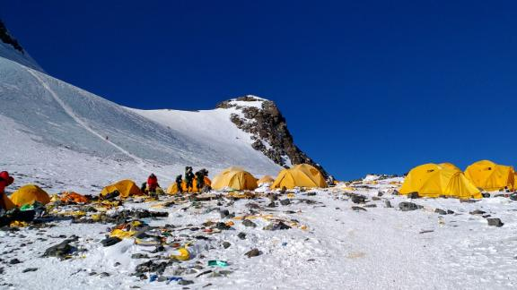 This picture taken on May 21, 2018 shows discarded climbing equipment and rubbish scattered around Camp 4 of Mount Everest. -