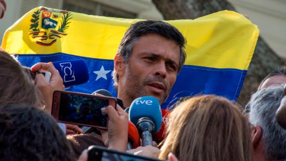 Opposition Leader Leopoldo Lopez speaks to the media at the gate of the Spanish ambassador