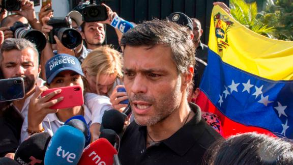 Opposition activist Leopoldo Lopez speaks to the media at the gate of the Spanish ambassador