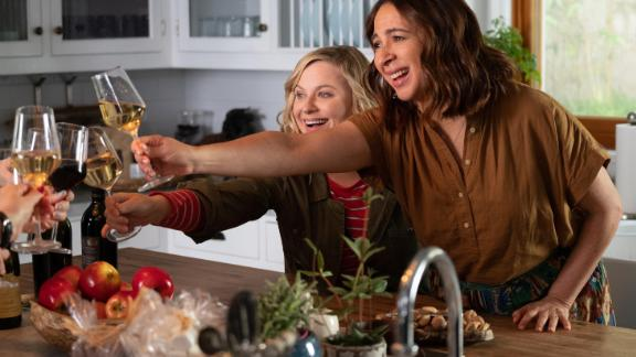 """Amy Poehler and Maya Rudolph share a toast in """"Wine Country."""""""