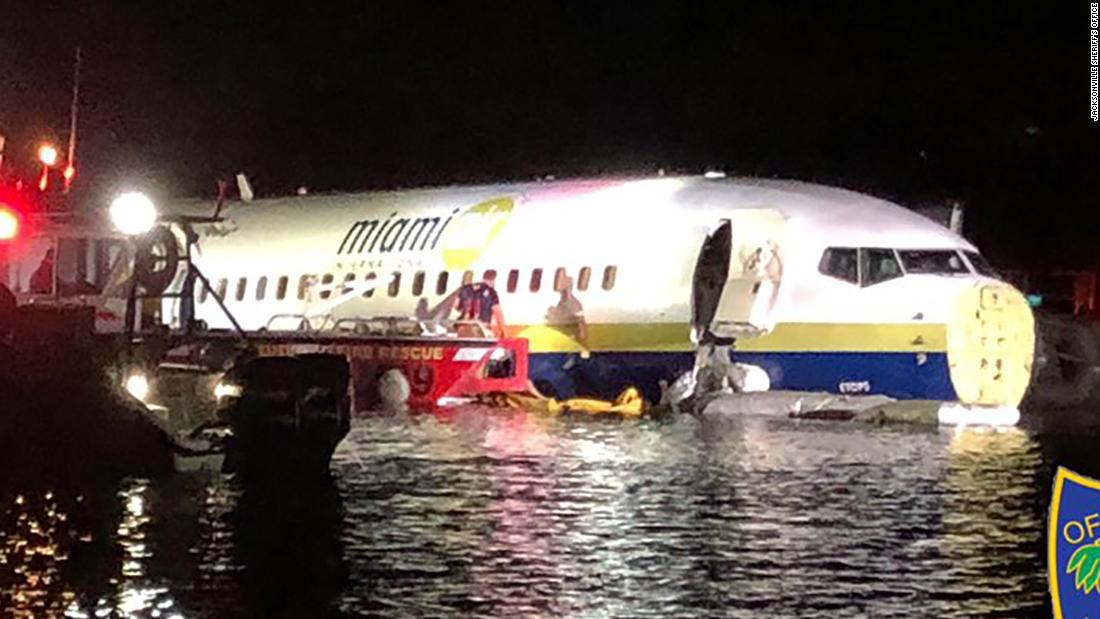 A Boeing 737 coming from Guantanamo Bay slid off the runway and fell into St. Johns River in Florida, officials say