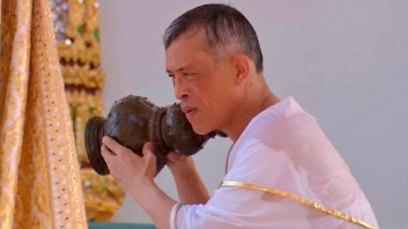 King Maha Vajiralongkorn takes part in the royal purification ceremony at the Grand Palace. Holy water from symbolic vessels is poured over the King's back and into his hands. Some of the water vessels contain holy water collected from all 76 provinces around the country.