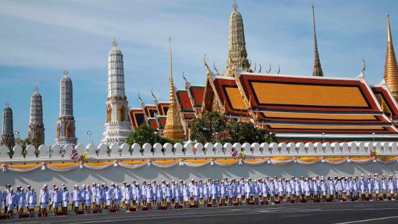 Thai officials stand outside the Grand Palace in Bangkok on May 4.