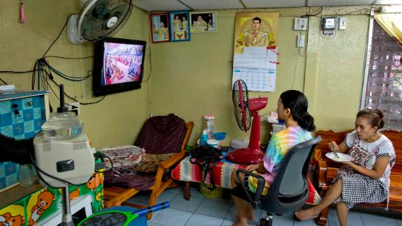 People in a beauty salon watch a live broadcast of the coronation ceremony.