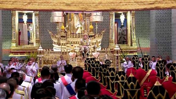 King Vajiralongkorn sits on the throne before an audience of diplomats and dignitaries at the Grand Palace on May 4.