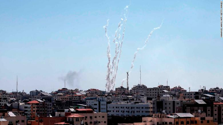 The Iron Dome aerial defense system intercepted dozens of the incoming rockets, the IDF says.