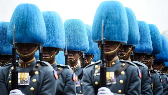 Thai Royal Guards march along a street near the Grand Palace during the coronation of the Thai King on Saturday, May 4.