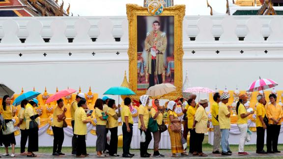 Well-wishers line up in front of a portrait of King Vajiralongkorn outside the Grand Palace in Bangkok on May 4.