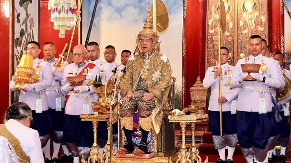 The chief brahmin prays before Thai King Maha Vajiralongkorn Bodindradebayavarangkun after all royal regalia items have been presented to him during his coronation ceremony at the Grand Palace in Bangkok on May 4.