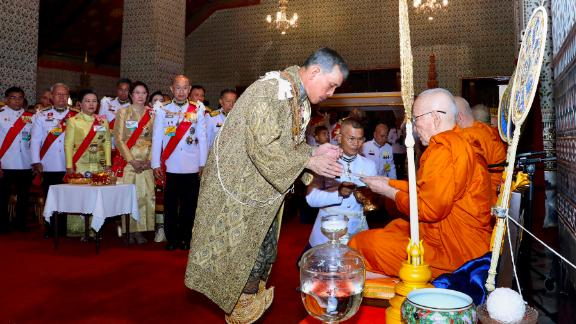 The Thai monarch offers a donation to a senior Buddhist monk at the Grand Palace on May 4.