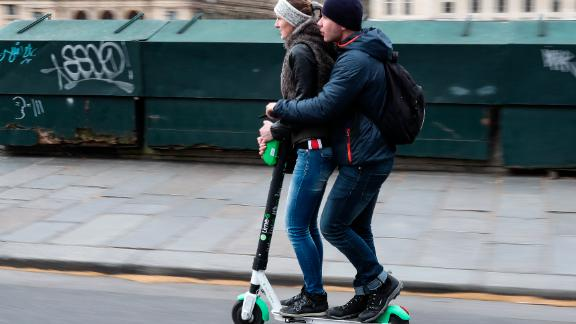 People use an Lime-S electric scooter of the US company Lime in Paris on March 3, 2019 in Paris. (Photo by KENZO TRIBOUILLARD / AFP)        (Photo credit should read KENZO TRIBOUILLARD/AFP/Getty Images)