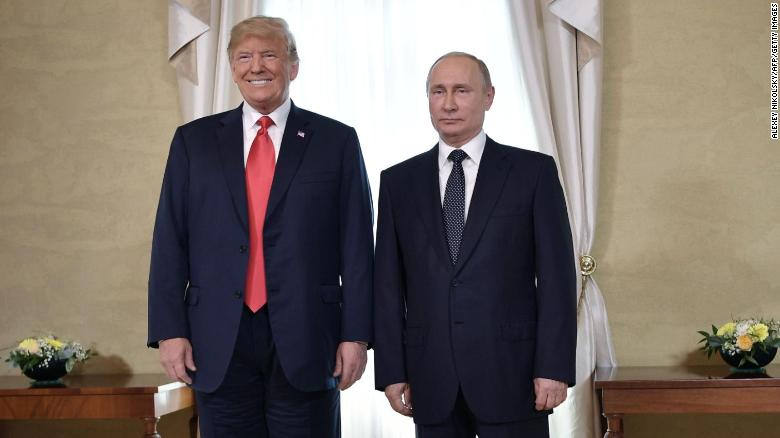 US President Donald Trump (left) and Russian President Vladimir Putin pose ahead a meeting in Helsinki, July 2018.