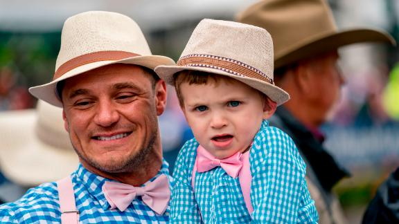 A man and a young boy wear matching outfits.