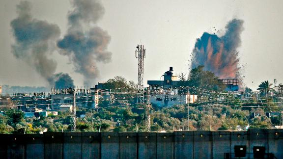 A picture taken from the southern Israeli village of Netiv Haasara shows an explosion and smoke fumes caused by an Israeli airstike across the border in the Gaza Strip on May 4, 2019. - Gaza militants fired a barrage of dozens of rockets at Israel, which responded with strikes that killed a Palestinian today officials said, as a fragile ceasefire again faltered. (Photo by Thomas COEX / AFP)        (Photo credit should read THOMAS COEX/AFP/Getty Images)