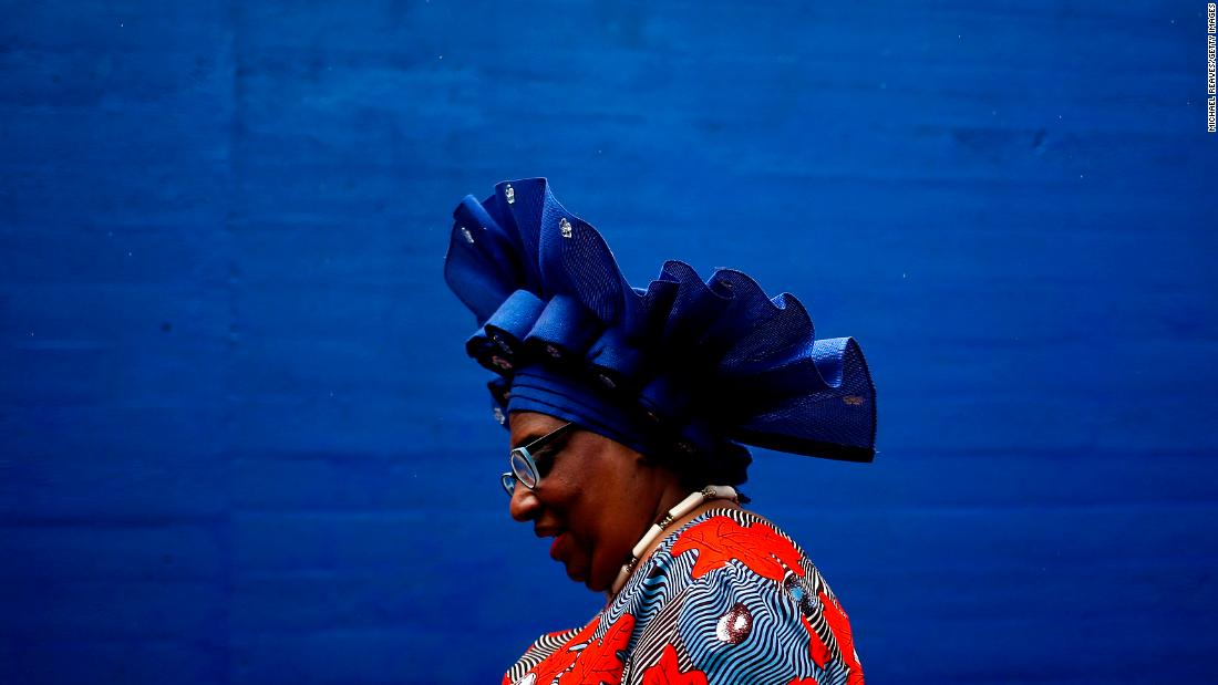 A woman wearing a festive hat attends the 145th running of the Kentucky Derby at Churchill Downs.