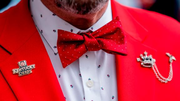 A man wears a rose themed shirt and jacket combo prior to the Kentucky Derby.