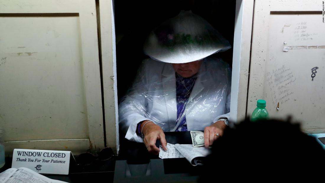 A woman places a bet before the 145th running of the Kentucky Derby Churchill Downs.