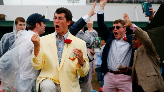 Fans react to a race prior to the Kentucky Derby at Churchill Downs.