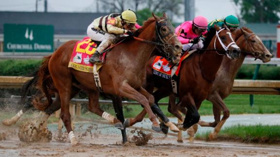 Luis Saez rides Maximum Security, center, to victory during the 145th running of the Kentucky Derby horse race at Churchill Downs Saturday, May 4, 2019, in Louisville, Ky. (AP Photo/John Minchillo)