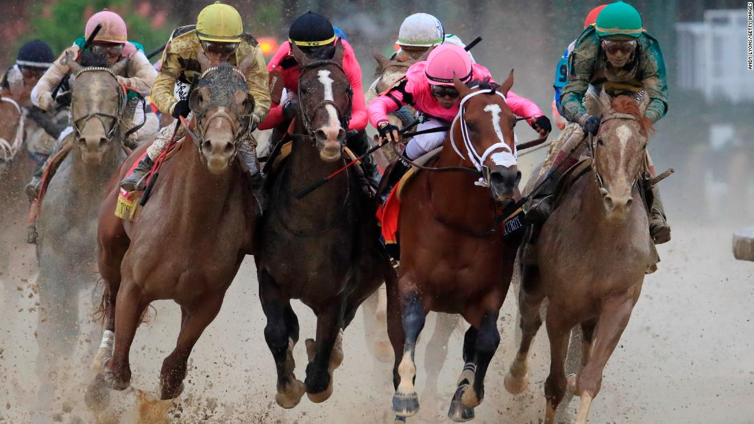 From left, Country House, War of Will, Maximum Security and Code of Honor fight for position in the final turn.