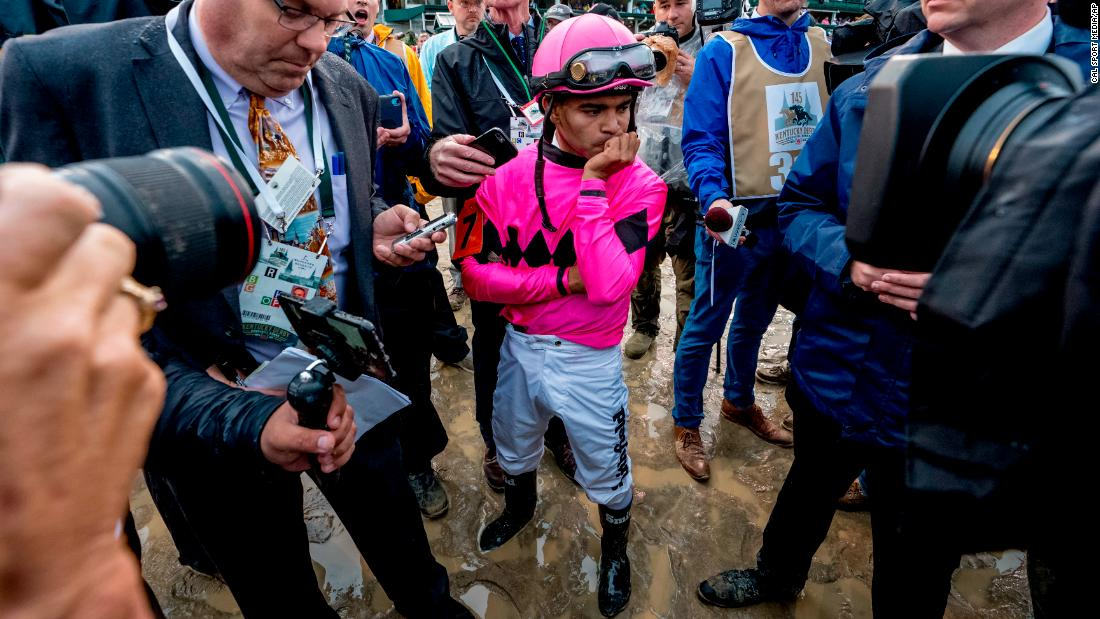 Luis Saez, jockey of Maximum Security, reacts after learning of his disqualification.