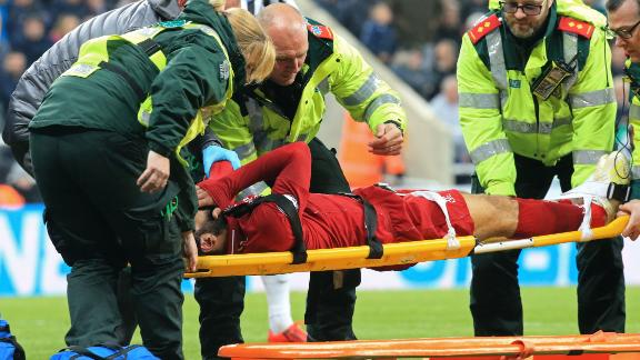 Salah is placed on a stretcher after suffering a head injury against Newcastle.