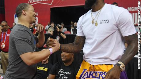 LAS VEGAS, NV - JULY 15:  Head coach Tyronn Lue (L) of the Cleveland Cavaliers greets LeBron James of the Los Angeles Lakers after a quarterfinal game of the 2018 NBA Summer League between the Lakers and the Detroit Pistons at the Thomas & Mack Center on July 15, 2018 in Las Vegas, Nevada. NOTE TO USER: User expressly acknowledges and agrees that, by downloading and or using this photograph, User is consenting to the terms and conditions of the Getty Images License Agreement.  (Photo by Ethan Miller/Getty Images)