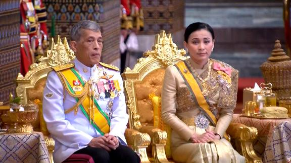In this image, taken from video, King Maha Vajiralongkorn and Queen Suthida attend attend a ceremony that includes bestowing royal titles and granting ranks at the Grand Palace in Bangkok on May 5.