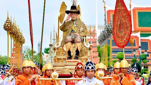 Royal bearers transport Thailand's King Maha Vajiralongkorn on the royal palanquin during his visit to the Temple of the Emerald Buddha in Bangkok on Saturday, May 4.