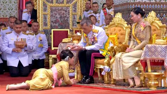 In this image taken from Thai TV, King Maha Vajiralongkorn and Queen Suthida attend a coronation ceremony that includes bestowing of the royal title and ranks to royals at the Grand Palace in Bangkok on Sunday.