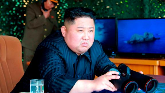 This Saturday, May 4, 2019, photo provided on Sunday, May 5, 2019, by the North Korean government shows North Korean leader Kim Jong Un, equipped with binoculars, observing tests of different weapons systems, in North Korea. North Korean state media on Sunday said leader Kim observed live-fire drills of long-range multiple rocket launchers and unspecified tactical guided weapons, a day after South Korea