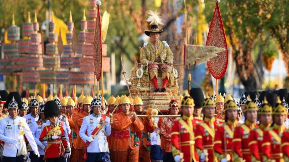 Thailand's King Maha Vajiralongkorn is carried in a golden palanquin during a coronation procession in Bangkok on Sunday, May 5.