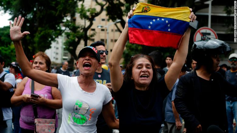 Guaidó's supporters shout slogans at a demonstration in Caracas on May 4.