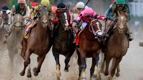 LOUISVILLE, KENTUCKY - MAY 04: Country House #20, ridden by jockey Flavien Prat, War of Will #1, ridden by jockey Tyler Gaffalione , Maximum Security #7, ridden by jockey Luis Saez and Code of Honor #13, ridden by jockey John Velazquez fight for position in the final turn during the 145th running of the Kentucky Derby at Churchill Downs on May 04, 2019 in Louisville, Kentucky. Country House #20 was declared the winner after a stewards review disqualified Maximum Security #7. (Photo by Andy Lyons/Getty Images)