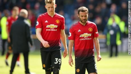 Juan Mata and Scott McTominay look forlorn after the draw.