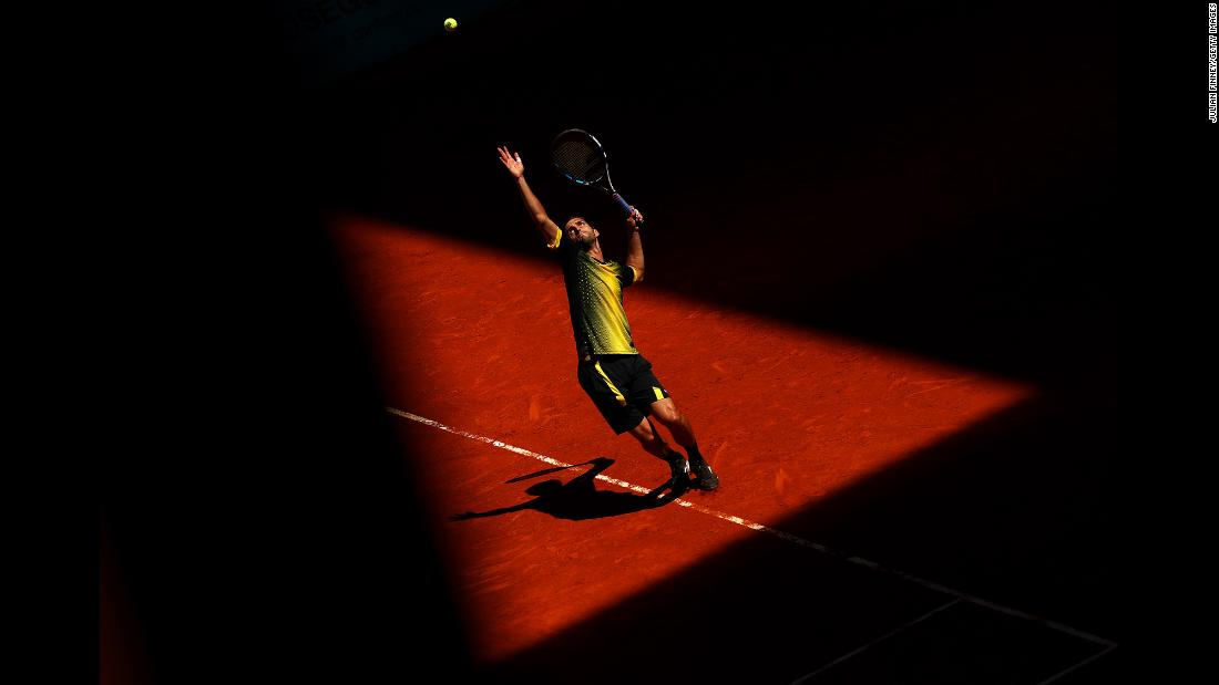 Albert Ramos-Vinolas of Spain serves to Taro Daniel of Japan during day one of the Mutua Madrid Open at La Caja Magica on Saturday, May 4, in Madrid.