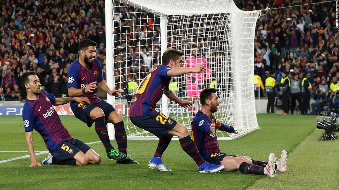 "Lionel Messi celebrates with teammates Sergi Roberto, Luis Suarez and Sergio Busquets after scoring a goal off a <a href=""https://bleacherreport.com/articles/2834036-lionel-messi-scores-600th-barcelona-goal-with-stunning-free-kick-vs-liverpool"" target=""_blank"">free-kick</a> during a Champions League Semi Final match against Liverpool on May 1 in Barcelona, Spain. The goal marked Messi's 600th career goal as a member of FC Barcelona."