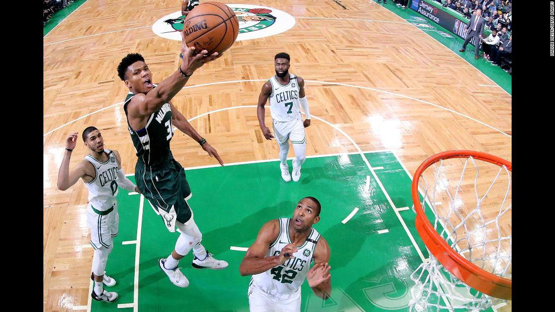 Giannis Antetokounmpo of the Milwaukee Bucks takes a shot over Al Horford (42) of the Boston Celtics during Game 3 of the NBA Eastern Conference Semifinals at TD Garden on May 3 in Boston, Massachusetts. The Bucks defeated the Celtics 123 - 116.