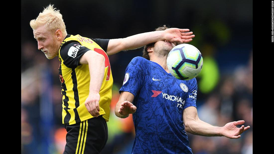 Watford's midfielder Will Hughes, left, smacks Chelsea's Marcos Alonso in the face while making a play on the ball during a Premier League match in London, England on Sunday, May 5.