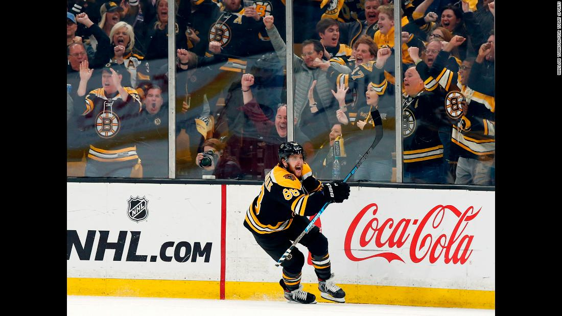 Boston Bruins right wing David Pastrnak celebrates after scoring the game-winning goal against the Columbus Blue Jackets during game five of the second round of the 2019 Stanley Cup Playoffs at TD Garden in Boston, Massachusetts.