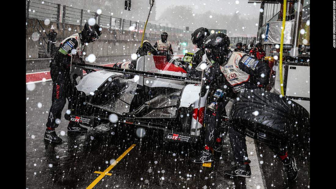 The #08 Toyota, driven by Sebastien Buemi, Kazuki Nakajima, and Fernando Alonso makes a pit stop as snow falls at the WEC Six Hours of Spa on May 4 in Stavelot, Belgium.