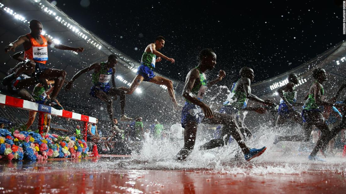 Athletes compete in the Men's 3,000-meter Steeplechase during the IAAF Diamond League event at the Khalifa International Stadium on Friday, May 3, in Doha, Qatar.